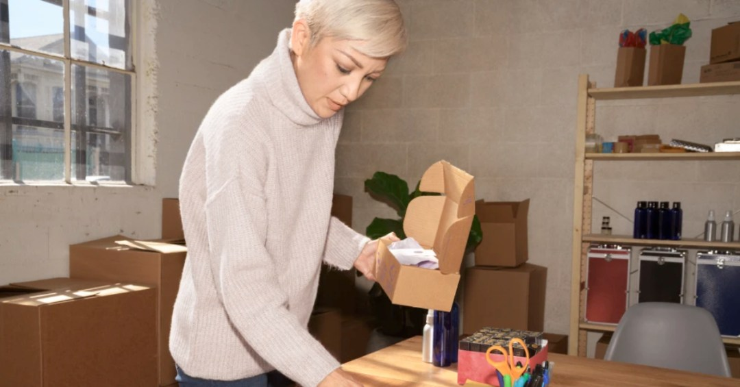 woman with a box of goods