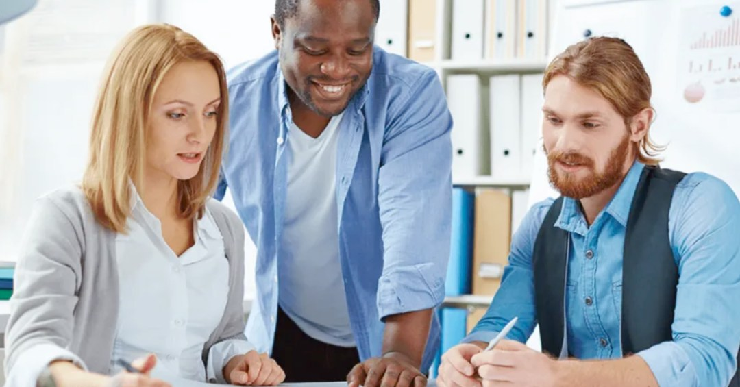 three people around conference table