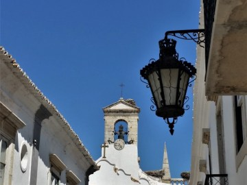 Faro old town gate with fado portuguese guitar
