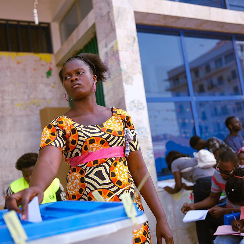 A woman votes in legislative elections in Bissau, Guinea-Bissau.