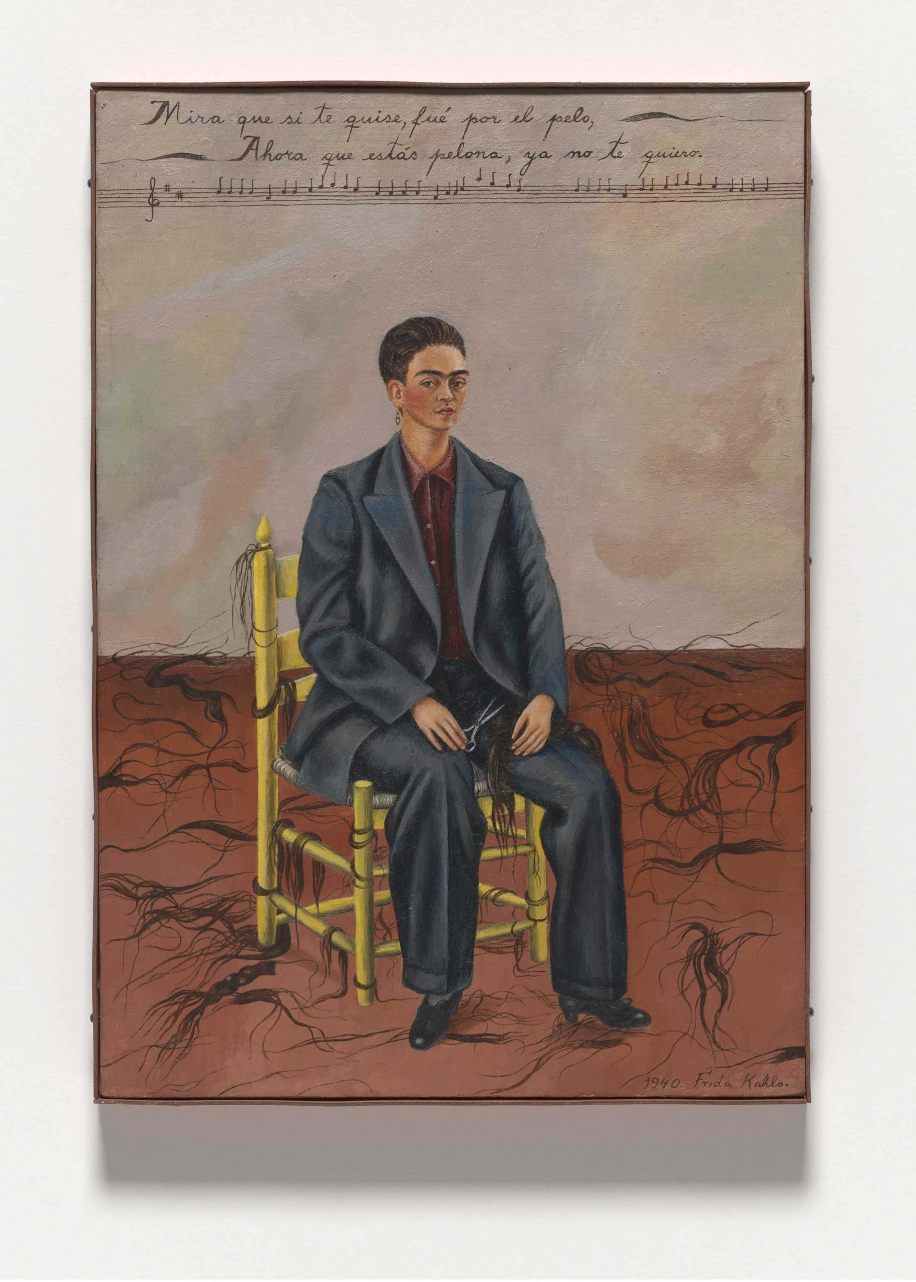 """""""Self Portrait with Cropped Hair,"""" © 2019 Banco de México Diego Rivera Frida Kahlo Museums Trust, Mexico, D.F. / Artists Rights Society (ARS), New York. <br/> Frida Kahlo painted her 1940 """"Self Portrait with Cropped Hair"""" shortly after divorcing Diego Rivera"""