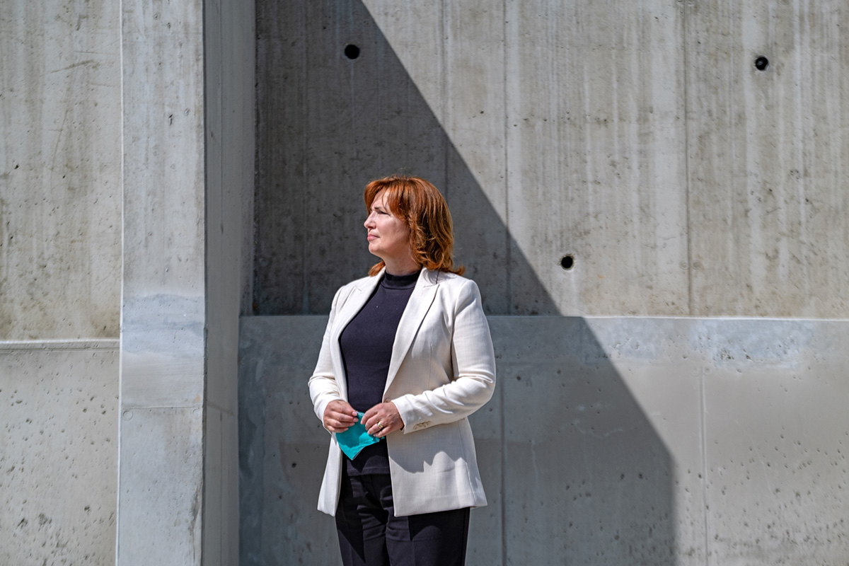Dana Čahojová, the Mayor of Karlova Ves Borough in Slovakia's capital city, inspects the reconstruction of a retaining wall next to heavily populated apartment buildings on June 12, 2020. Cracks in the retaining wall threatened the safety of local residents, necessitating urgent repairs.
