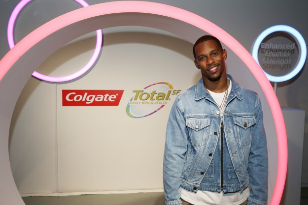 IMAGE DISTRIBUTED FOR COLGATE - Football Wide Receiver, Victor Cruz, explores the science behind the new Colgate Total (SF) at the Colgate Total (SF) Experience on Thursday, Jan. 31, 2019 in New York. (Donald TrailAP Images for Colgate)