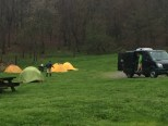 Setting up our base camp in the rain