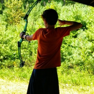A Scout Participating in an Open-Shoot at the Archery Range