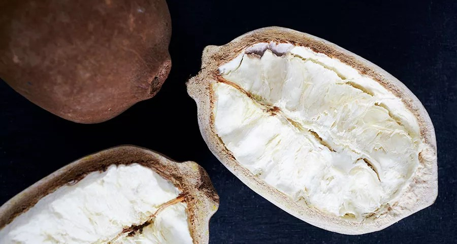 """Cupuacu or Cupuaçu - The cupuacu fruit is long-shaped, heavy and has a rough """"shell"""" that protects a white pulp inside."""