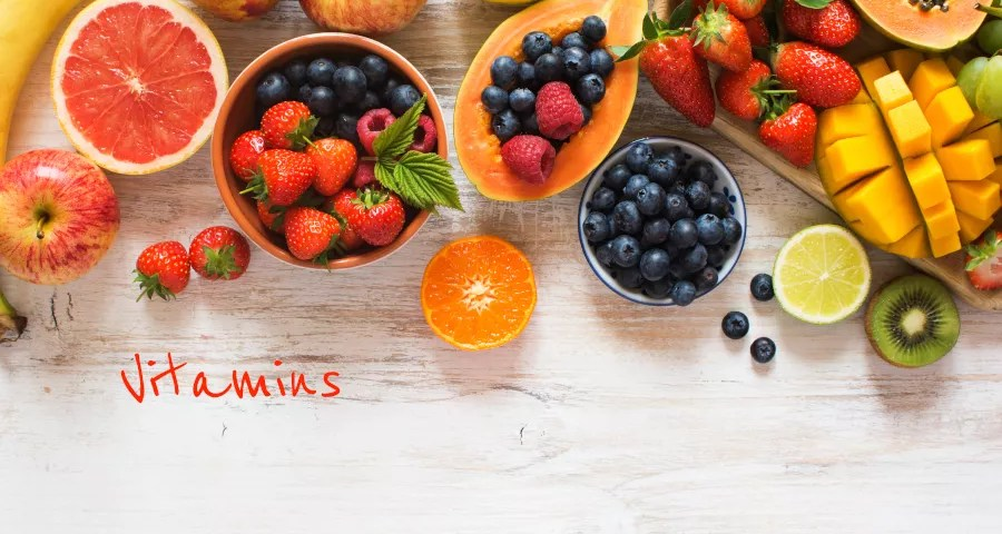 Vitamins - a image of dozens of fruits over a table