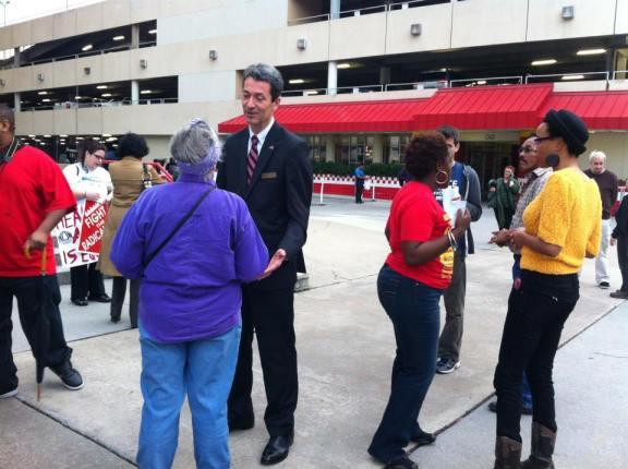Dr. Rad speaking to Medicaid activists