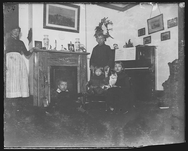 """""""Richmond Hill, the parlor - flash-light"""", the Riis children in the Richmond Hill home, circa 1890-1904, Prints and Photographs Division, Library of Congress"""