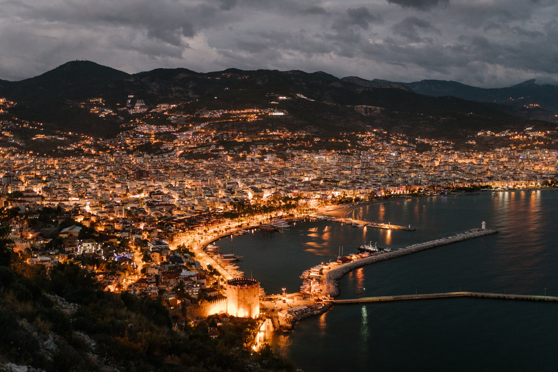picturesque scenery of coastal town in night illumination