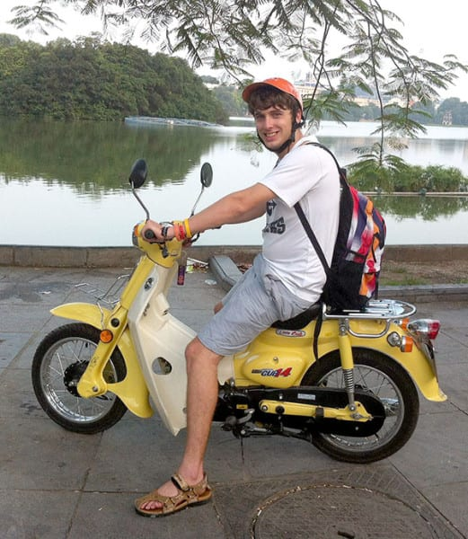 Yen Bui photo Chad Downs at Hoang Kiem lake in Hanoi, Vietnam. He experienced culture change when he came to Troy and again when he went abroad.