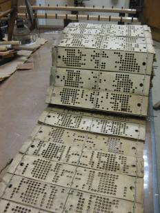 Cards found on Lowry Jacquard with new lacing board. Photo courtesy Lang Pioneer Village Museum.