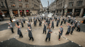 54 pizza chefs bring London's Oxford Street to a standstill with synchronized pizza flare