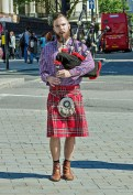 busking with bagpipes at Trafalgar Square, London U.K.