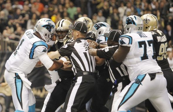 newton-cam-newton-curtis-lofton-nfl-carolina-panthers-new-orleans-saints-590x900