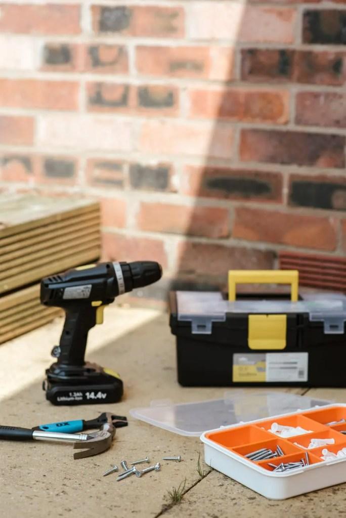 repair tools near brick wall