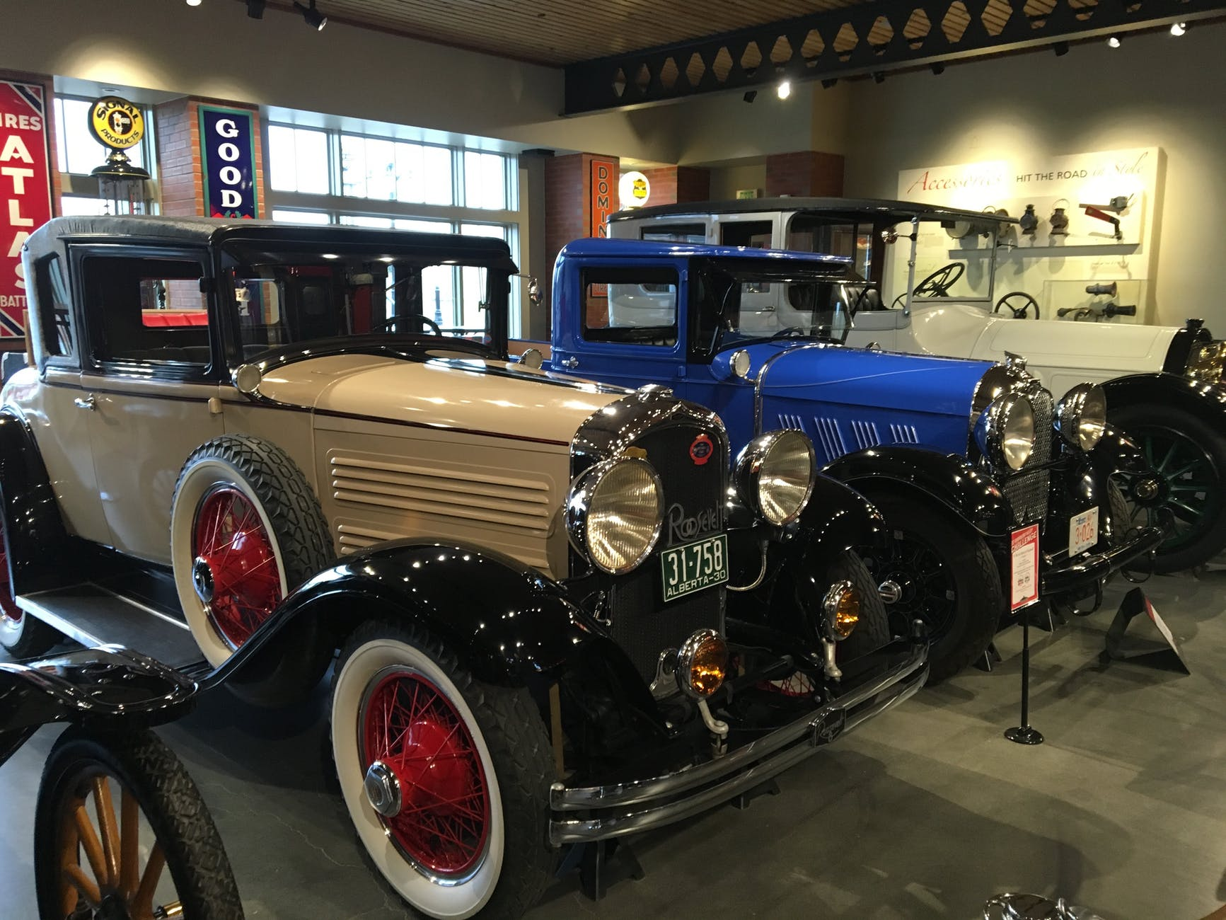 assorted vintage cars in a well lighted room