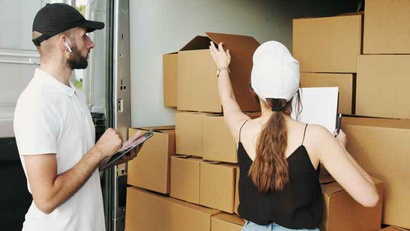 man and woman checking the packages