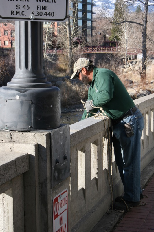 Steve Pacheco, fishing for trash. March 5, 2015.