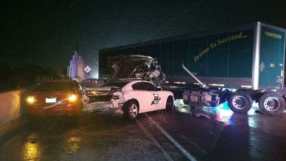 tractor trailer hits police car