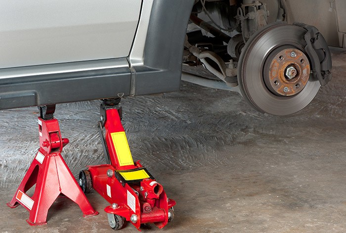 Extra safety measures are taken  by using a hydraulic jack and jack stand to lift up a vehicle.