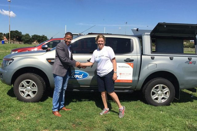 Ensly Dooms from Ford South Africa and Paula Barnard from World Vision SA at the official handover of the Ford Rangers in Soweto, Johannesburg.