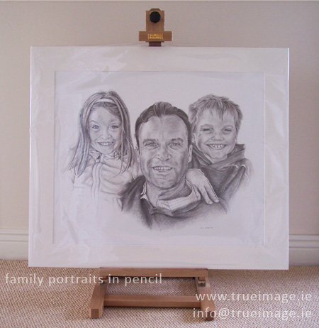 Finished family portrait mounted and wrapped in clear plastic ready for posting