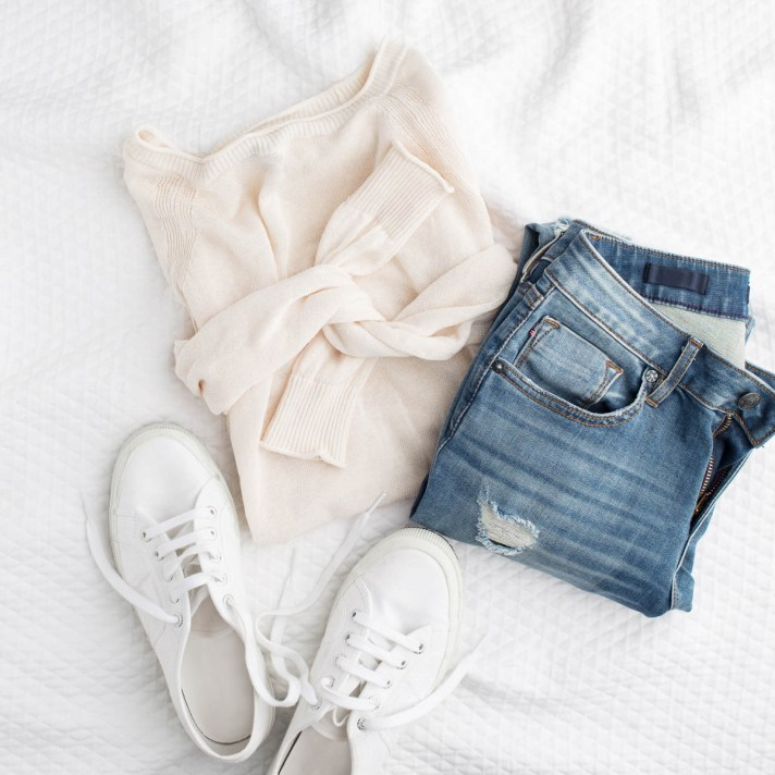 White sweater, jeans and white sneakers outfit for dressing casually image consulting