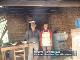 Margarito and his sister Maria in front of their old house