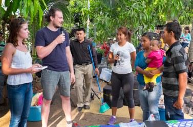 Tyler and Jodi presenting the keys to the Bladimir family