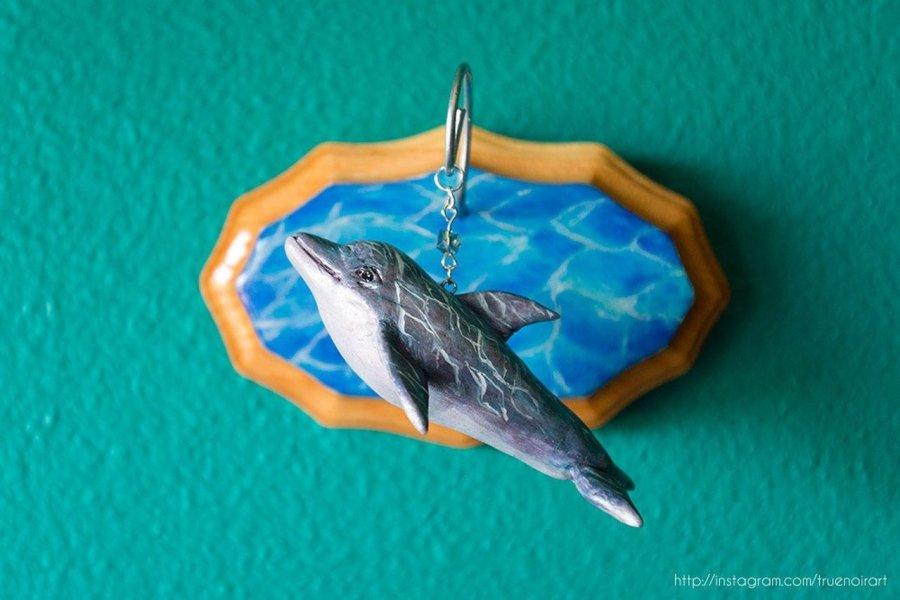 Dolphin wall sculpture by Oksana Ossipov