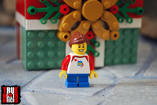 Front view of the Buildable Holiday Present child Minifigure.