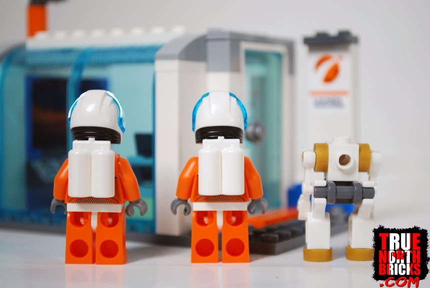 Rear view of astronaut Minifigures and robot.