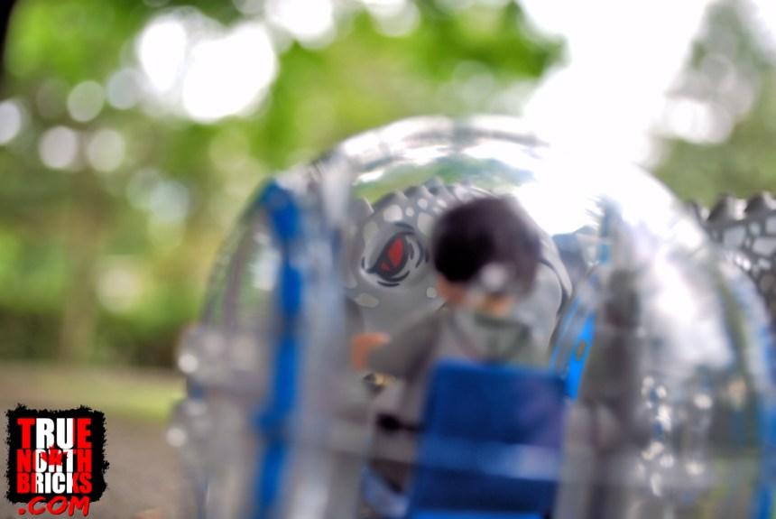Indominus rex eyeing gyrosphere.