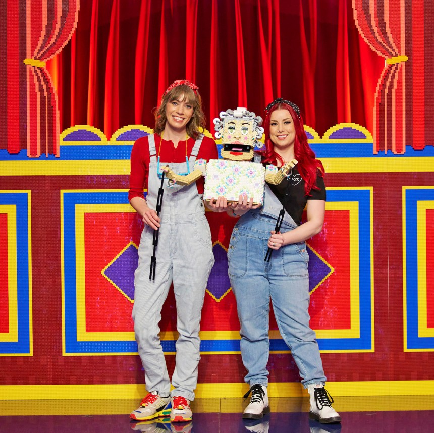 Natalie and Michelle with their puppet.