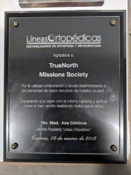 """TNMS was presented with a plaque from a Cuenca orthopedic supply business. Translated the plaque reads """"For the valuable collaboration and interested help to the low income people of our city. Hoping that they continue with the same charisma and attitude as they have been doing all these years."""""""