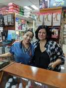 Pam Railton with Santa Ines pharmacist