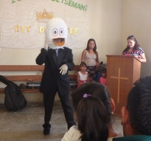 This lady in a duck-man suit brought a light moment to the service with a silly song.