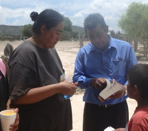 Martin presented one of our big print Bibles with an inscription to this lady. She made a first time profession of faith.