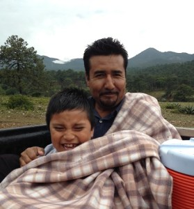 Pastor Reynaldo and son rode in the back of the truck.