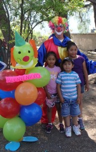 Kids liked to pose with the clown by the clown balloons.