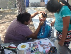 Patricia worked for hours painting faces.