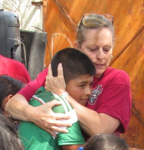 The kids were told to hug as if it were Jesus - it was a powerful time.