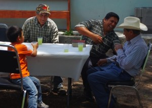 Evangelist Ramiro has a good laugh with some of the men at the gathering.