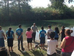 The Pastor preached a short sermon from the banks of the river.