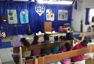 Martin, Yessi and her Mom decorated the church building with Bible characters.
