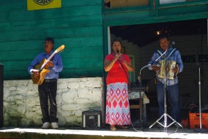 Sandra sings as Juan on the accordion and the guitar play.