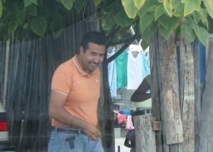 Pastor Reynaldo enjoys talking with folks as we deliver meals.