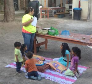 Some children sat on a blanket during the Bible story time.