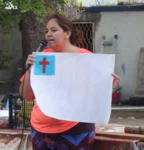 Yessi explains the meaning of the Christian flag.